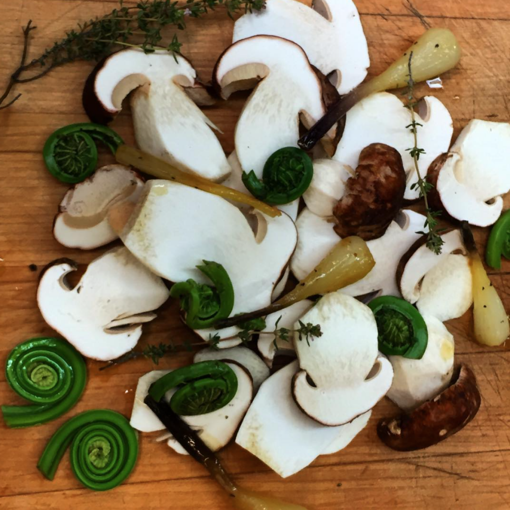 fresh Porcini mushrooms, fiddlehead ferns, and local ramps